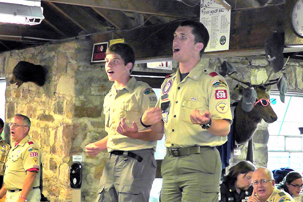 Leading the Scouts in songs at Camp K
